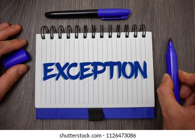 Word writing text Exception. Business concept for Person or thing that is excluded from general statement Different Man hold holding blue marker notebook page paper ideas wooden background.