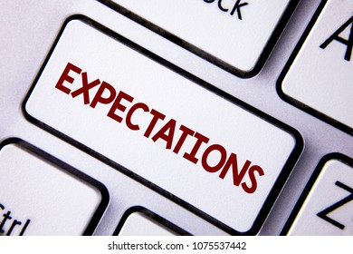 Word writing text Expectations. Business concept for Huge sales in equity market assumptions by an expert analyst written on white Keyboard Key with copy space. Top view.