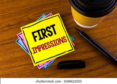 Word writing text First Impressions. Business concept for Encounter presentation performance job interview courtship written Sticky Note Paper wooden background Marker Cup next to it.