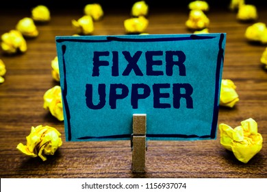 Word writing text Fixer Upper. Business concept for house in need of repairs used chiefly connection with purchase Clothespin holding blue paper note crumpled papers several tries mistakes.