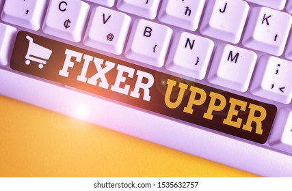 Word writing text Fixer Upper. Business concept for house in need of repairs used chiefly connection with purchase White pc keyboard with empty note paper above white background key copy space.