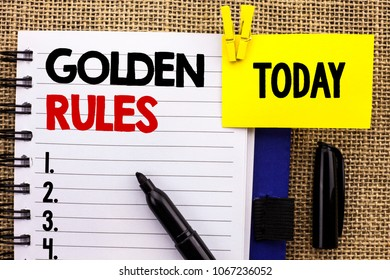 Word writing text Golden Rules. Business concept for Regulation Principles Core Purpose Plan Norm Policy Statement written Notebook book jute background Today with Clip Marker next to it.