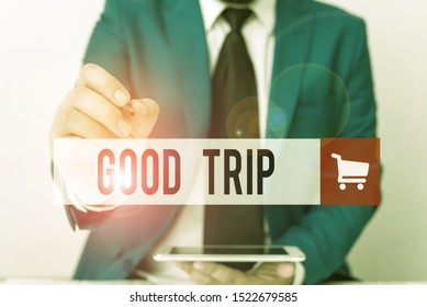 Word writing text Good Trip. Business concept for A journey or voyage,run by boat,train,bus,or any kind of vehicle Businessman pointing with pen in empty copy space.