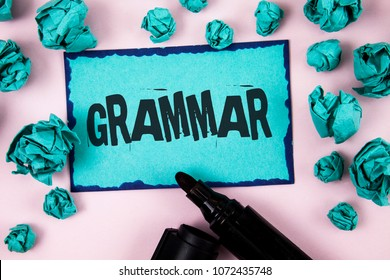 Word writing text Grammar. Business concept for System and Structure of a Language Correct Proper Writing Rules written Sticky Note paper plain Pink background Paper Balls and Marker.