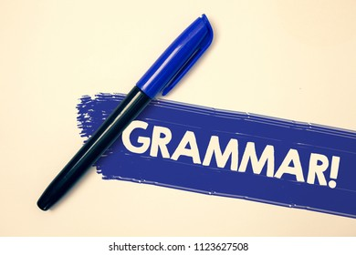 Word writing text Grammar Motivational Call. Business concept for System and Structure of a Language Writing Rules Ideas messages faded painting blue pen beige background paint idea message.