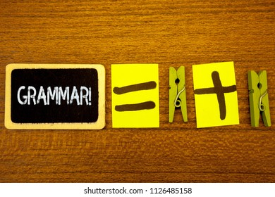 Word writing text Grammar Motivational Call. Business concept for System and Structure of a Language Writing Rules Ideas blackboard chalk equal plus signs clothespins wooden background.