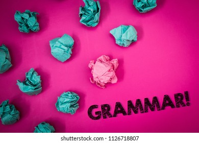 Word writing text Grammar Motivational Call. Business concept for System and Structure of a Language Writing Rules Ideas messages thoughts pink background crumpled papers several tries.