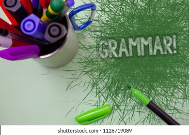 Word writing text Grammar Motivational Call. Business concept for System and Structure of a Language Writing Rules Scratched table cup with markers ideas messages workspace messy stain.