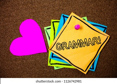 Word writing text Grammar Motivational Call. Business concept for System and Structure of a Language Writing Rules Ideas messages paper pink heart cork background love lovely thoughts.