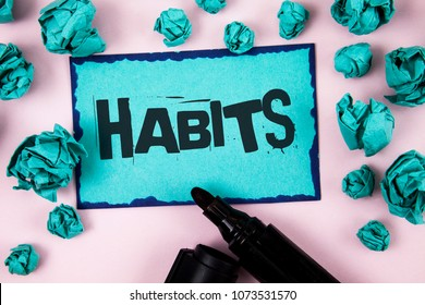 Word writing text Habits. Business concept for Regular tendency or practice Routine Usual Manners Behavior Pattern written on Sticky Note paper on plain Pink background Paper Balls and Marker.