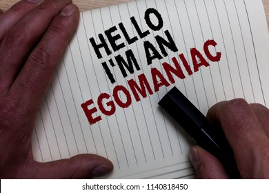 Word writing text Hello I am An Egomaniac. Business concept for Selfish Egocentric Narcissist Self-centered Ego Man's hand grasp black marker with some black and red texts on white page.