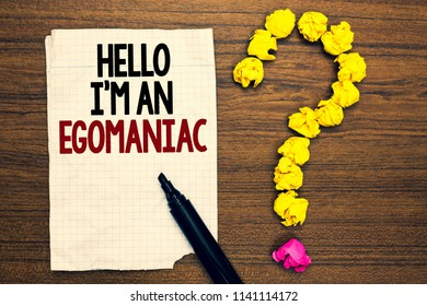 Word writing text Hello I am An Egomaniac. Business concept for Selfish Egocentric Narcissist Self-centered Ego Written torn page touch black pen yellow paper lob form question on woody deck.