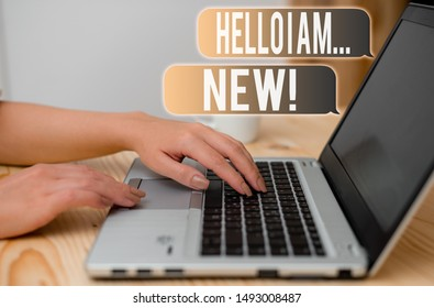 Word writing text Hello I Am New. Business concept for used as greeting or to begin telephone conversation woman laptop computer smartphone mug office supplies technological devices.