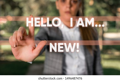 Word writing text Hello I Am New. Business concept for used greeting or begin telephone conversation Business woman in the nature pointing with the finger into empty space.