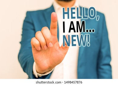 Word writing text Hello I Am New. Business concept for used greeting or begin telephone conversation Businessman in blue suite and white shirt pointing with finger in empty space.