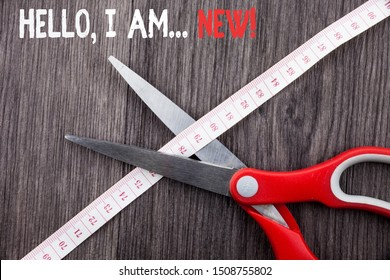 Word writing text Hello I Am New. Business concept for used greeting or begin telephone conversation Front view wooden background scissors cutting through tape measuring diet.