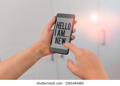 Word writing text Hello I Am New. Business concept for Introduce yourself Meeting Greeting Work Fresh worker School woman using smartphone office supplies technological devices inside home.