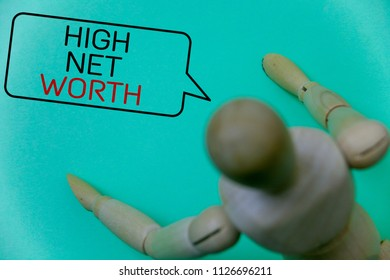 Word writing text High Net Worth. Business concept for having high-value Something expensive A-class company Cyan background robot imaginations idea message template thoughts doll.