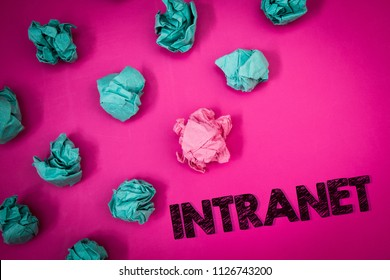Word writing text Intranet. Business concept for Private network of a company Interlinked local area networks Ideas messages thoughts pink background crumpled papers several tries.