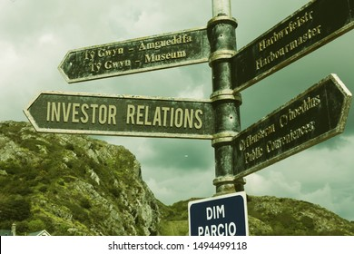Word writing text Investor Relations. Business concept for analysisagement responsibility that integrates finance Road sign on the crossroads with blue cloudy sky in the background.