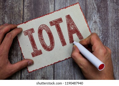 Word writing text Iota. Business concept for Crypto currency platform Ledger that records the online transactions