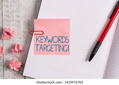 Word writing text Keywords Targeting. Business concept for Use Relevant Words to get High Ranking in Search Engines Thick pages notebook stationary placed above classic look wooden backdrop.