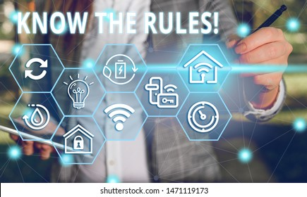Word writing text Know The Rules. Business concept for set explicit or regulation principles governing conduct Female human wear formal work suit presenting presentation use smart device.
