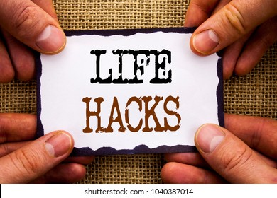 Word, writing, text  Life Hacks. Conceptual photo Solution Hacking Hack Trick To Help Efficiency written Sticky Note Paper Holding Hand with Finger.