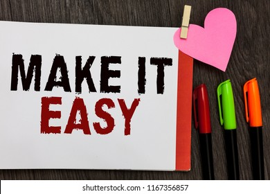 Word writing text Make It Easy. Business concept for Smart approach Effortless Free from worries or difficulties Open notebook page markers clothespin holding paper heart wooden background.