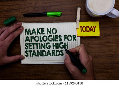 Word writing text Make No Apologies For Setting High Standards. Business concept for Seeking quality productivity Man holding marker notebook clothespin reminder wooden table cup coffee.