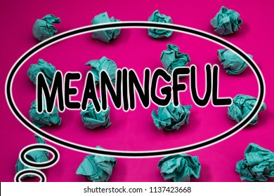 Word writing text Meaningful. Business concept for Having meaning Significant Relevant Important Purposeful Crumpled paper balls pattern eliptical design animated font background.