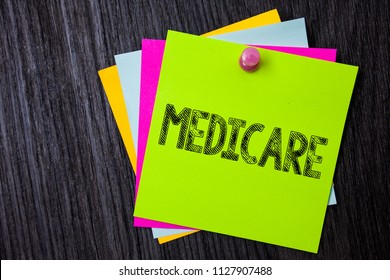 Word writing text Medicare. Business concept for Federal health insurance for people above 65 or with disabilities Multiple sticky cards pinned coclourfull dark lining background board.