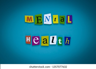 A word writing text - mental health - of cut letters on a blue background. Headline - mental health. Banner with inscription - mental health. Psychologic concept.