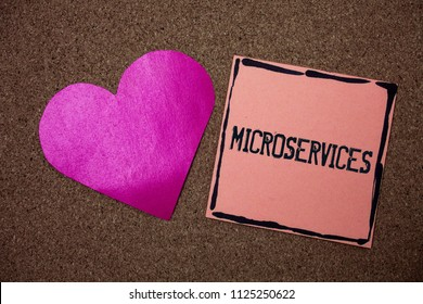 Word writing text Microservices. Business concept for Software development technique Decomposing an application Love heart sticky small papers remember rough dark background line drawing.