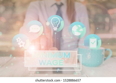 Word writing text Minimum Wage. Business concept for the lowest wage permitted by law or by a special agreement Female human wear formal work suit presenting presentation use smart device.