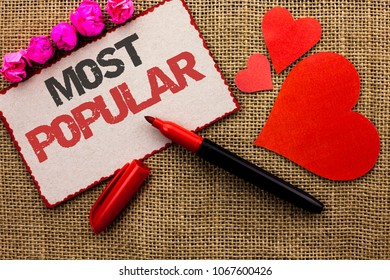 Word writing text Most Popular. Business concept for Top Rating Bestseller Favorite Product or Artist 1st in ranking written on Cardboard Piece on the jute background Marker and Hearts next to it.