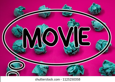 Word writing text Movie. Business concept for Cinema or television film Motion picture Video displayed on screen Crumpled paper balls pattern eliptical design animated font background.