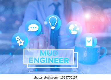 Word writing text Mud Engineer. Business concept for liable for making mixture of fluids used in drilling process Female human wear formal work suit presenting presentation use smart device.