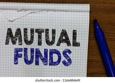 Word writing text Mutual Funds. Business concept for An investment program funded by shareholders Individual Stocks Marker besides notebook crumpled papers ripped pages several tries mistakes.