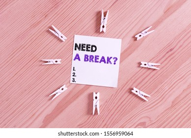 Word writing text Need A Brake Question. Business concept for More Time to Relax Chill Out Freedom Stress Free Colored clothespin papers empty reminder wooden floor background office.