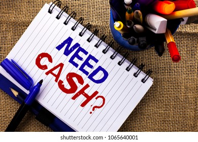 Word writing text Need Cash Question. Business concept for Wealth Question Needy Currency Money Advice Conceptual written on Notebook Book on the jute background Pencils next to it.