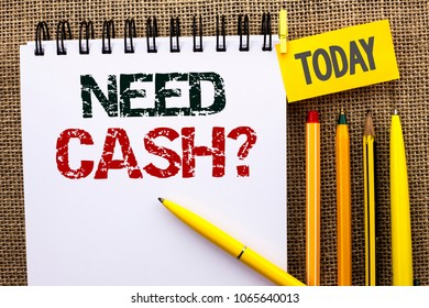 Word writing text Need Cash Question. Business concept for Wealth Question Needy Currency Money Advice Conceptual written on Notebook Book on the jute background Today Pens and Pencil next to it.