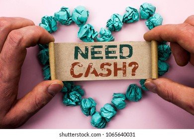 Word writing text Need Cash Question. Business concept for Wealth Question Needy Currency Money Advice Conceptual written on Cardboard Paper Holding by man plain background on Heart Paper Balls.