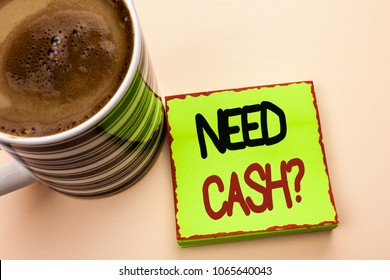 Word writing text Need Cash Question. Business concept for Wealth Question Needy Currency Money Advice Conceptual written on Green Sticky Note Paper on the plain background Coffee Cup next to it.