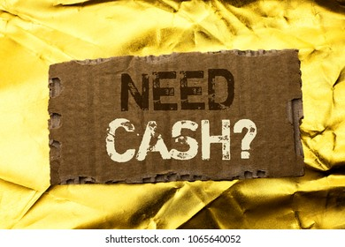 Word writing text Need Cash Question. Business concept for Wealth Question Needy Currency Money Advice Conceptual written on tear Cardboard Piece on the Golden textured background.