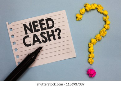 Word writing text Need Cash question. Business concept for asking someone if you need extra money or dont Paper marker crumpled papers forming question mark wooden background.