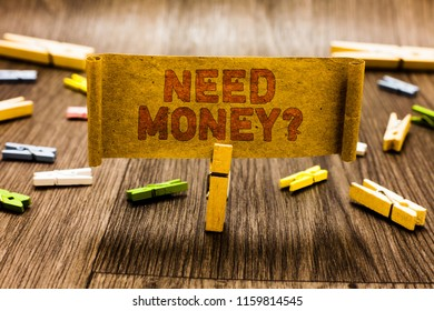 Word writing text Need Money question. Business concept for asking someone if he needs cash or bouns Get loan Clothespin holding old piece fabric several clothespins wooden floor.