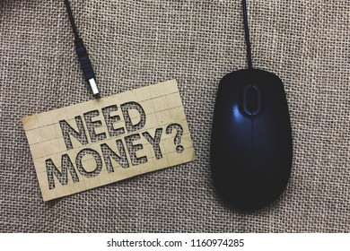 Word writing text Need Money question. Business concept for asking someone if he needs cash or bouns Get loan Paperboard computer mouse jute background Expressing ideas typing needs.