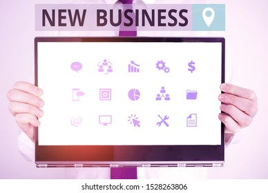 Word writing text New Business. Business concept for the activity of buying and selling goods and services Male human holding thick textured cardboard of business promotion concept.