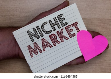 Word writing text Niche Market. Business concept for Subset of the market on which specific product is focused Man holding piece notebook paper heart Romantic ideas messages feelings.